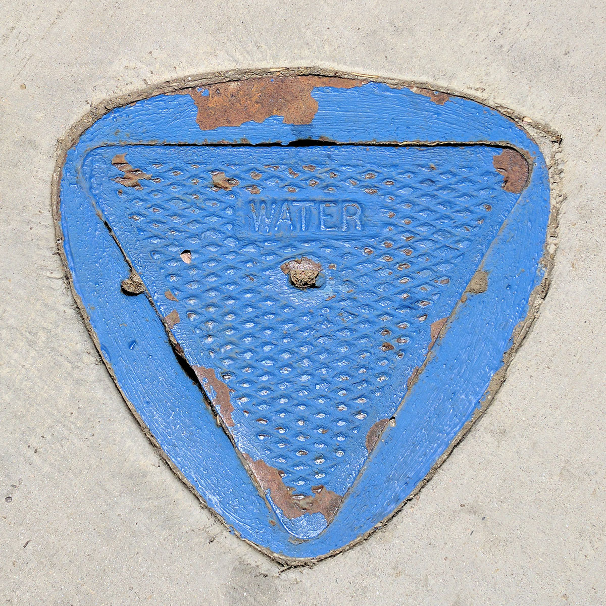 Blue metal utility cover for water