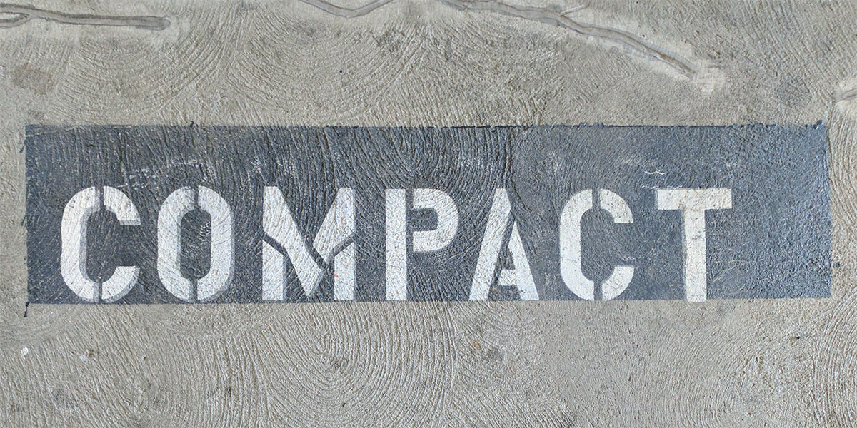 compact parking white lettering on black background